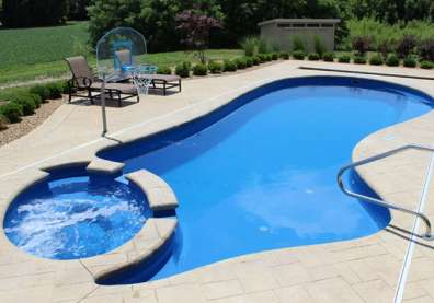Imagine Pools Brilliant pool model with built-in spa in Ocean Blue color