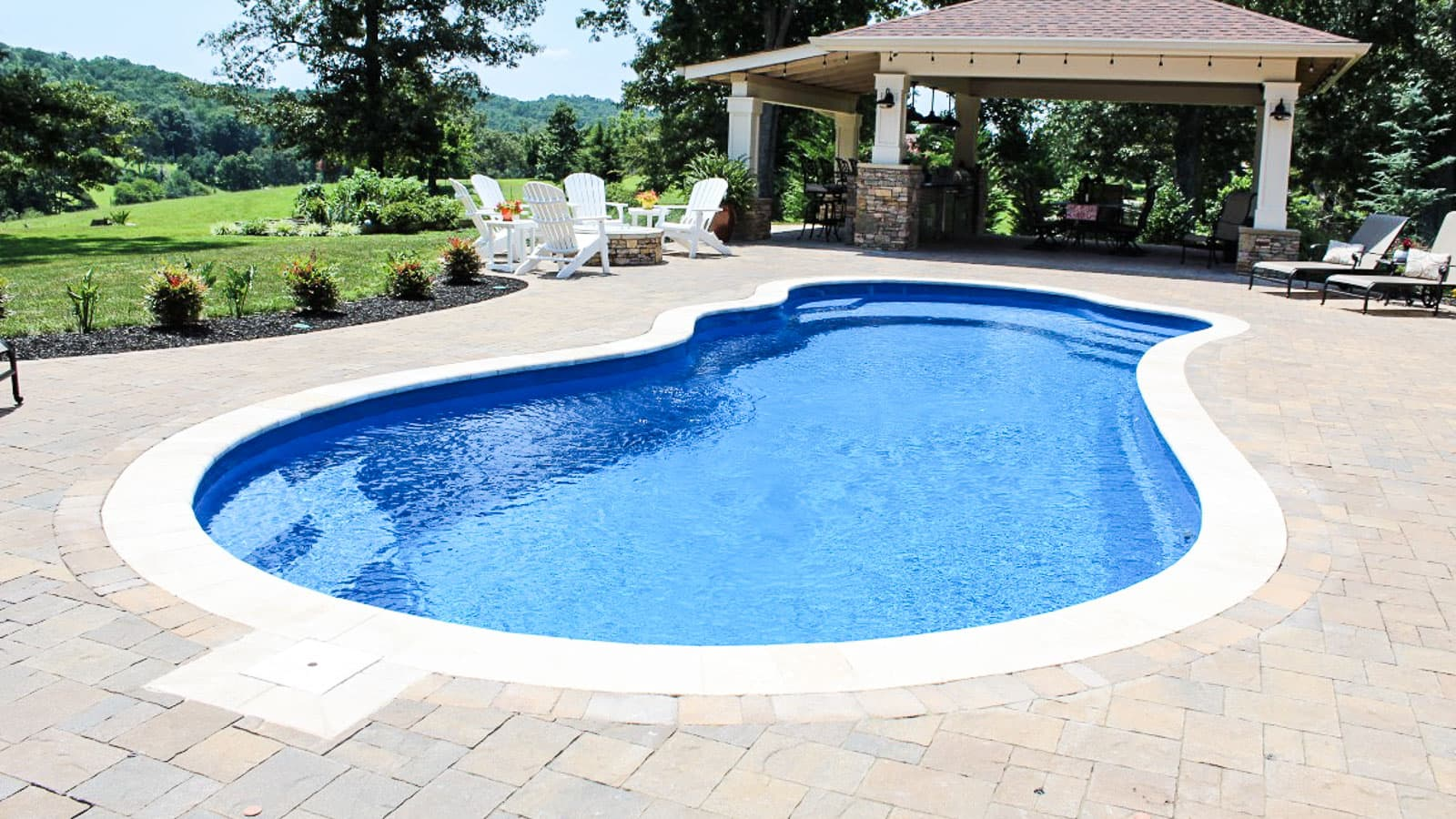 Imagine Pools Fantasy freeform pool model in Ocean Blue color